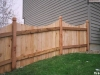 High Solid Board Scalloped Cedar Privacy Fence and Topped Posts