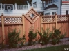 Lattice Top Wood Privacy Fence With Added Decoration