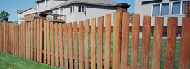 Scalloped cedar wood picket containment fence need it