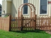 Traditional Topped Cedar Picket Fence with Arbor