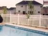 PVC Fence Surrounds Pool